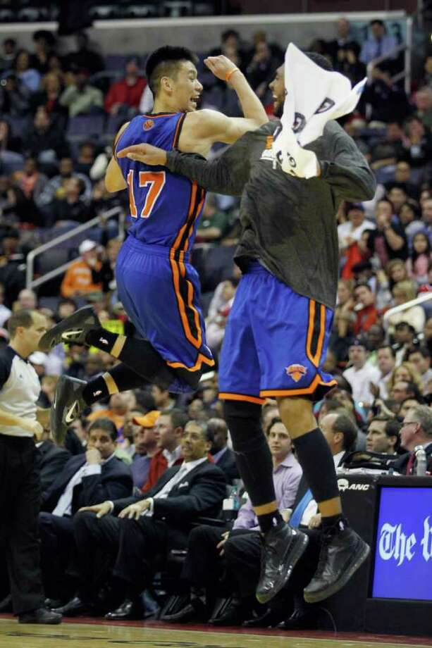 Jeremy Lin of the Knicks, left, and Jared Jeffries celebrate during Wednesday night's win at Washington. Photo: Rob Carr/Getty Images / 2012 Getty Images