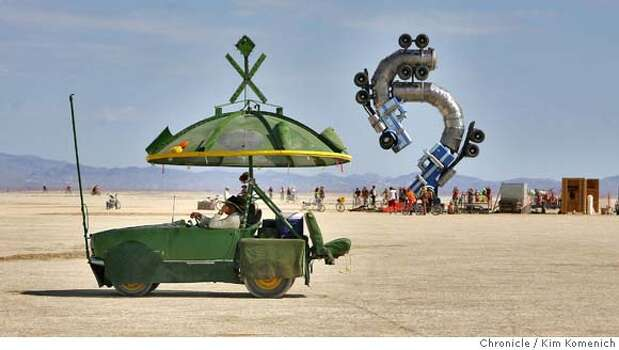 "An art car drives in front of Mike Ross's ""Big Rig Jig"" Thursday during Burning Man 2007 at Black Rock City, near Gerlach, Nevada.  Photo: Kim Komenich"
