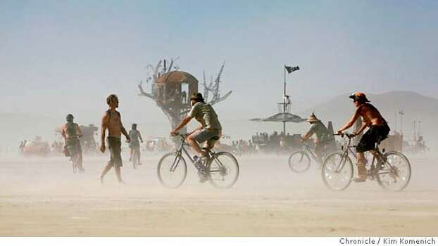 The intermittent dust storms didn't keep festivalgoers from looking at the art on the playa Saturday at the Burning Man Festival at Black Rock City, near Gerlach, Nevada.  Photo: Kim Komenich