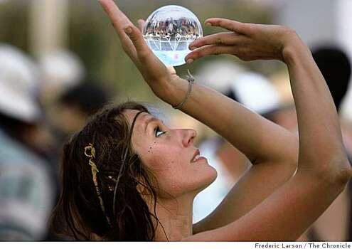 Anna Haraszti plays with a crystal ball at the center camp where afternoon entertainment happens during the 2009 Burning Man festival. Photo: Frederic Larson, The Chronicle