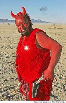 "Tim Nakayama (aka) ""Dirty Diabo"" from Portland Oregon gets into the spirit of Burning Man festival by wearing his devil suit out on a play at Black Rock NV, on August 29, 2008. Photo: Frederic Larson, The Chronicle"