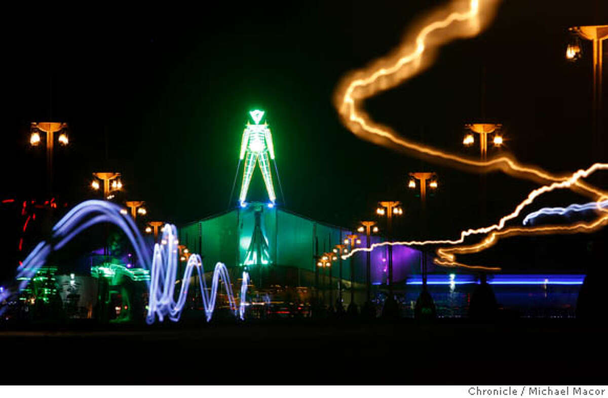 burningmangreen02_01_mac.jpg The final evening of the Green Man before Saturday night's burn. A time exposure shows people or vehicles with lights as they streak across the scene. Burning Man 2007. Photographed in, Black Rock City, Nv, on 8/31/07. Photo by: Michael Macor/ The Chronicle