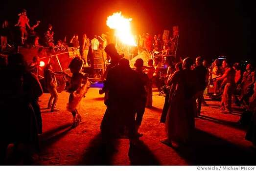 An art car blasts music and fire for burners as it travels the Playa during the 2007 festival.  Photo: Michael Macor