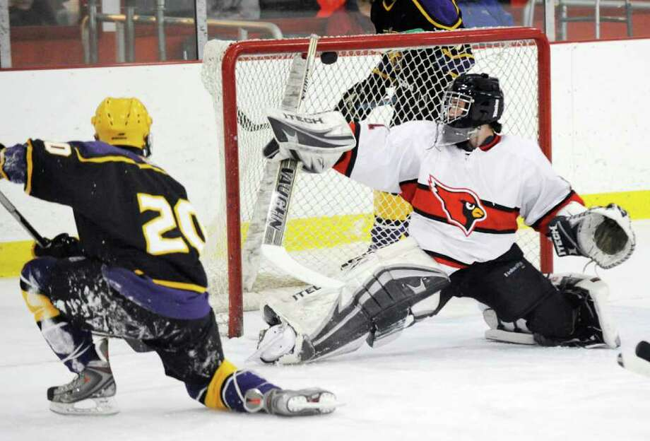 Lukas Znosko # 20 of Westhill scores on Greenwich goalie Vinny Scorese during lst period action in boys high school ice hockey game between Greenwich High School and Westhill High School at Hamill Rink in Byram Wednesday night, Feb. 8, 2012. Photo: Bob Luckey / Greenwich Time