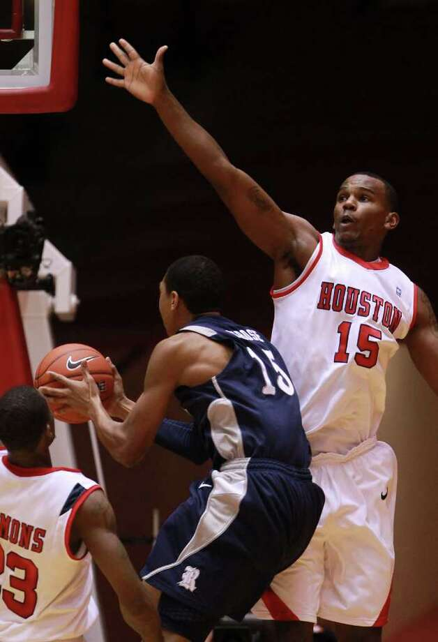 Rice University guard Julian DeBose (15) gets past University of Houston forward Leon Gibson (15) for a lay up during the first half of a NCAA basketball game, Wednesday, Feb. 8, 2012, in Hofheinz Pavillionin Houston. Photo: Nick De La Torre, Houston Chronicle / © 2012  Houston Chronicle
