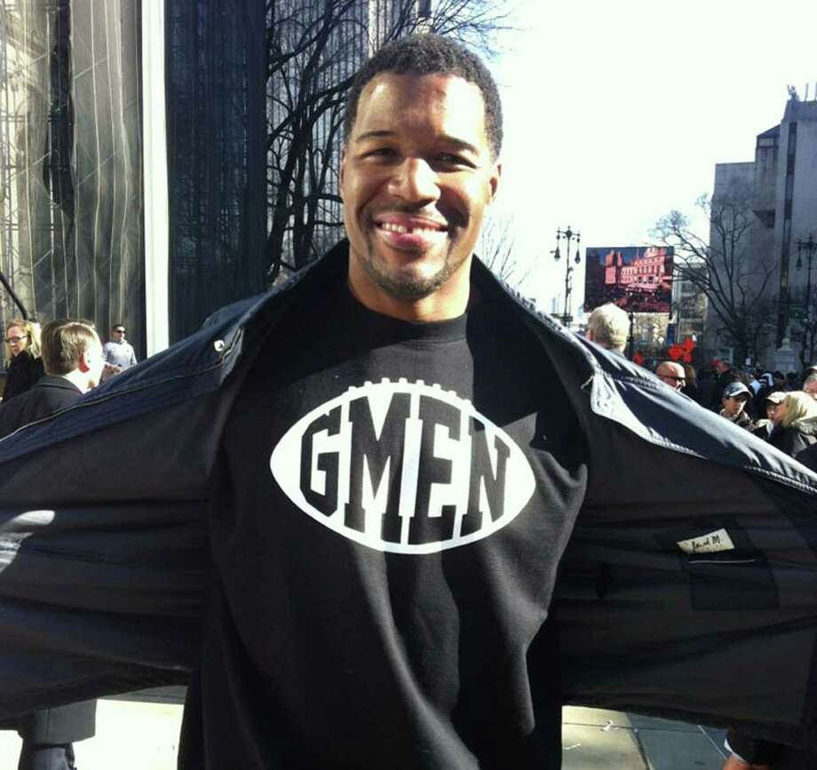 Michael Strahan wears a GMEN sweatshirt at yesterday's parade in New York celebrating the Giants Super Bowl win. Photo: Contributed Photo