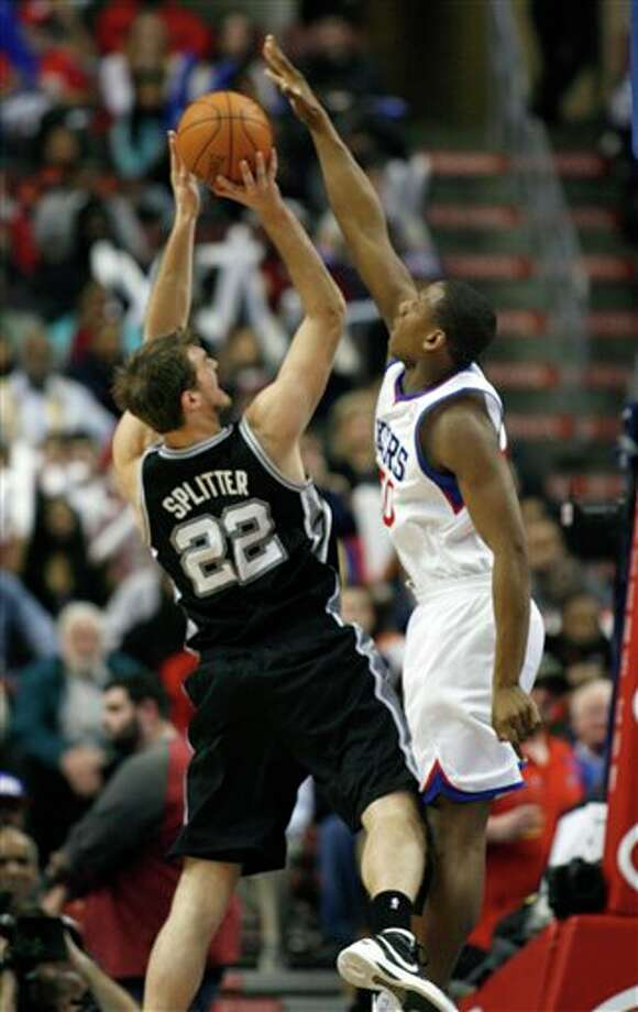 San Antonio Spurs' Tiago Splitter (22) has his shot blocked by  Philadelphia 76ers' Lavoy Allen in the second half of an NBA basketball game on Wednesday, Feb., 8, 2012, in Philadelphia. The Spurs won 100-90. (AP Photo/H. Rumph Jr ) Photo: H. Rumph Jr, Associated Press / FR61717 AP