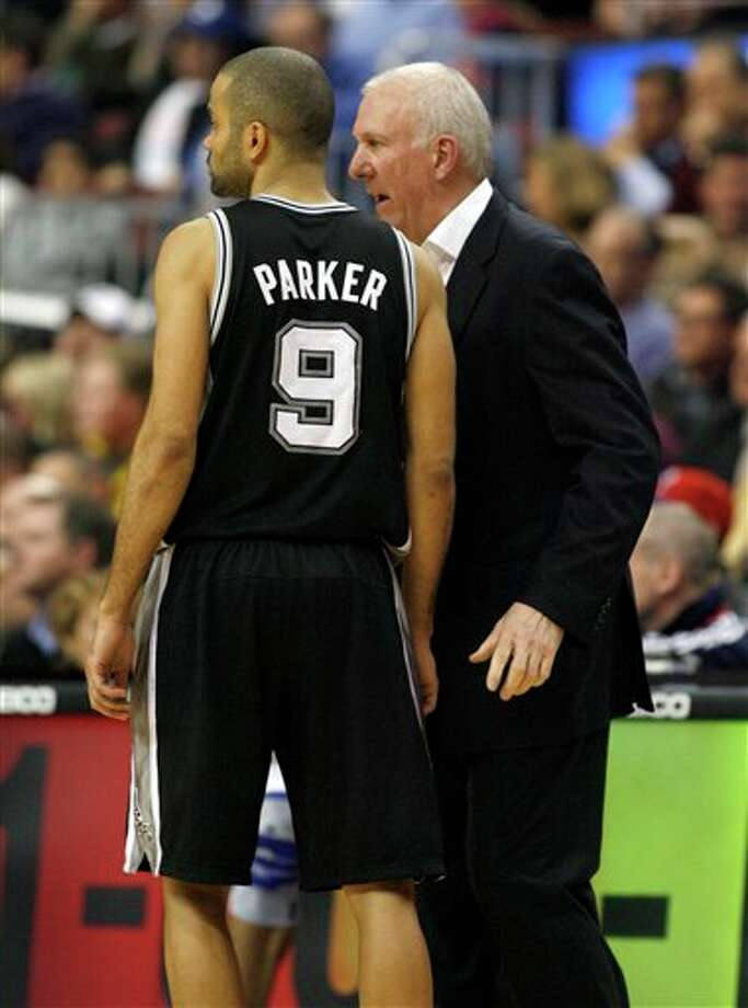 San Antonio Spurs coach Gregg Popovich, right, talks to Tony Parker(9) as they play against the Philadelphia 76ers in the second half of an  NBA basketball game on Wednesday, Feb., 8, 2012, in Philadelphia. The Spurs won 100-90. (AP Photo/H. Rumph Jr ) Photo: H. Rumph Jr, Associated Press / FR61717 AP