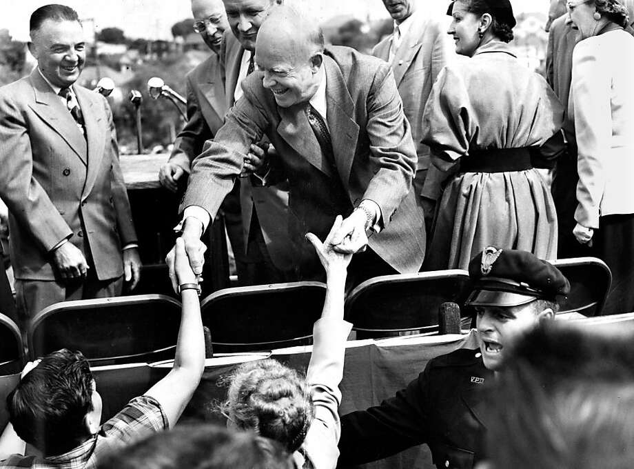 Dwight Eisenhower greets children while campaigning in Vallejo in 1952. During his presidency, political leaders worked with business interests. Photo: Chronicle Archives