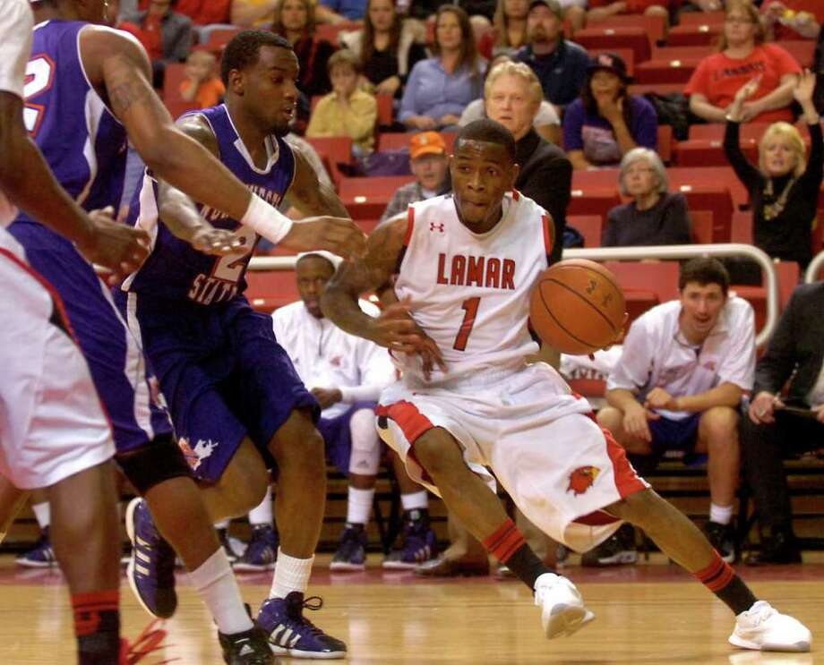 Lamar's Anthony Miles drives inside during the game against Northwestern State at the Montagne Center at Lamar University in Beaumont, Wednesday, February 8, 2012. Tammy McKinley/The Enterprise Photo: TAMMY MCKINLEY