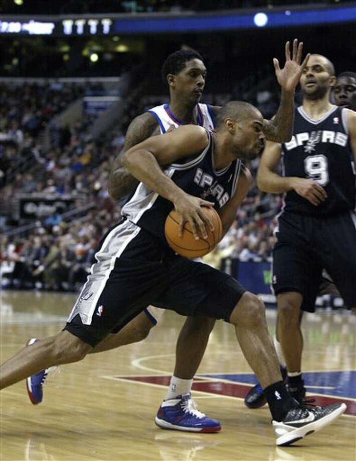 San Antonio Spurs' Gary Neal, , front left, drives against  Philadelphia 76ers' Lou Williams, behind, in the second half of an  NBA basketball game on Wednesday, Feb., 8, 2012, in Philadelphia. The Spurs won 100-90. (AP Photo/H. Rumph Jr ) Photo: H. Rumph Jr, Associated Press / FR61717 AP