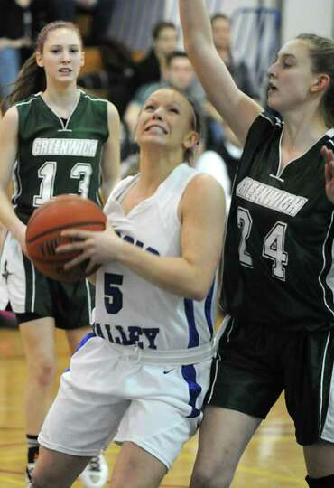 Hoosic Valley's Alicia Lewis is guarded by Samantha Linnett of Greenwich during a basketball game on