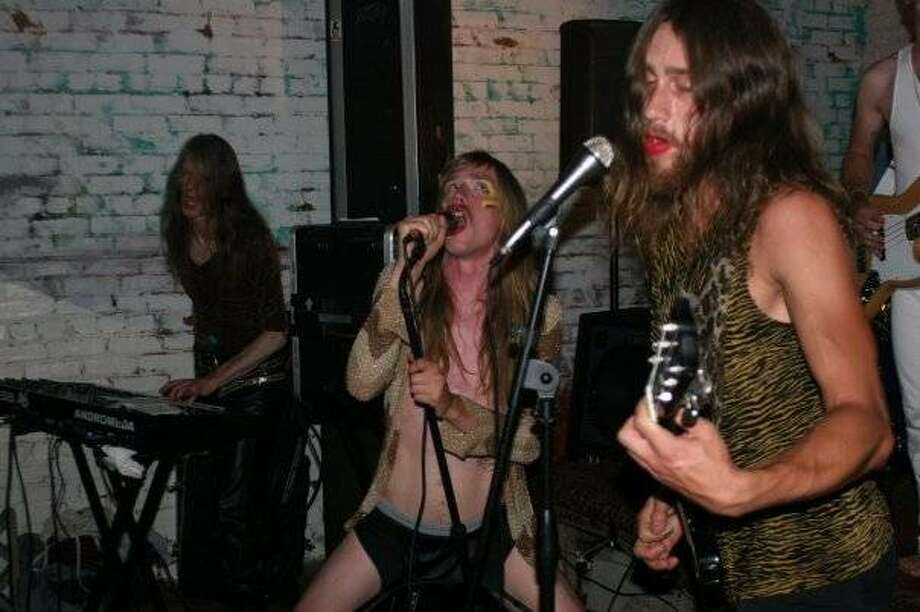"Doug Graves (left), Wendy Stonehenge (center) and Lorfin Terrafor (right) of ""stoner-glam"" band Glitter Wizard. Photo: Mish Way"