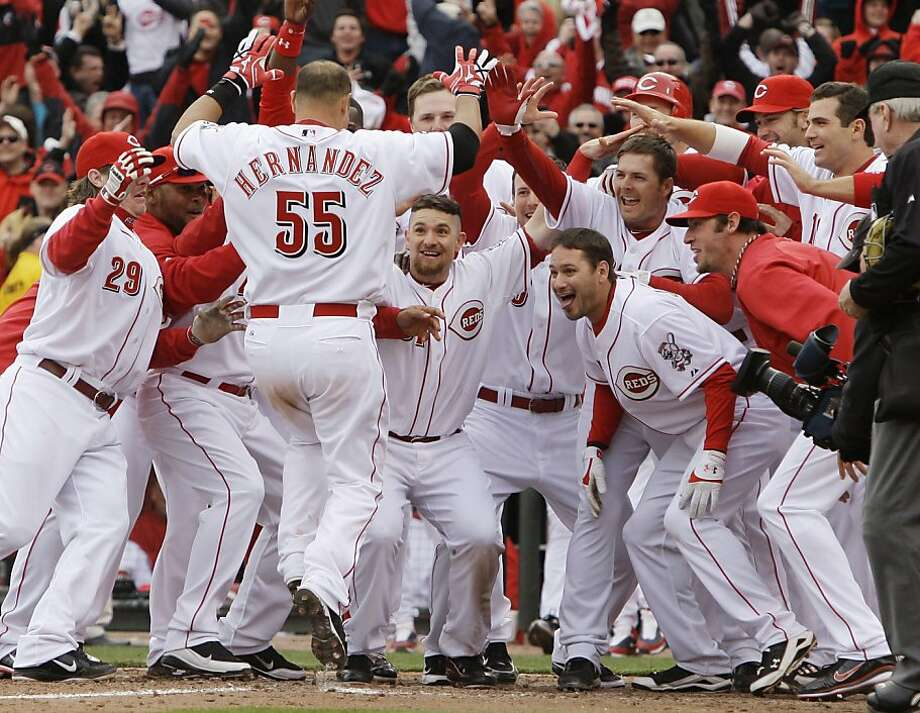Cincinnati Reds' Ramon Hernandez (55) is greeted by teammates at home plate after hitting the game-winning three-run home run off Milwaukee Brewers relief pitcher John Axford in the ninth inning of an opening day baseball game, Thursday, March 31, 2011 inCincinnati. The Reds won 7-6. Photo: Al Behrman, AP