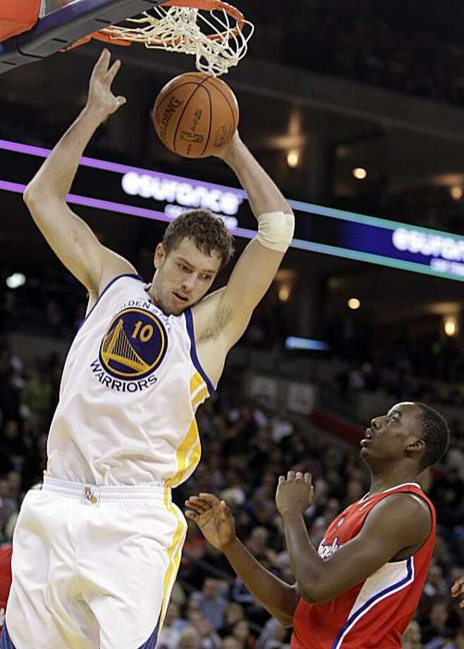 Golden State Warriors' David Lee, left, scores over Los Angeles Clippers' Al-Farouq Aminu during the second half of an NBA basketball game Friday, Jan. 14, 2011, in Oakland, Calif. Photo: Ben Margot, AP