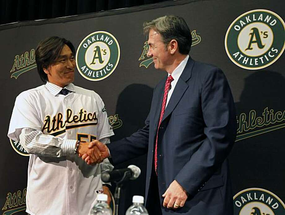 Oakland Athletics General Manager Billy Bean right shakes hands with the A's newest member Hideki Matsui during a press conference at the Oakland Coliseum Tuesday Dec 14, 2010 Photo: Lance Iversen, The Chronicle