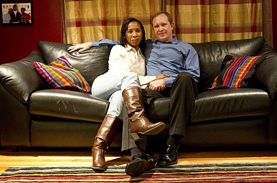 Gregoria Nova Cahill sits for a portrait with her husband Matthew Cahill on the couch at their home in San Francisco, Calif., on Monday, January 10, 2011.  She knew Matthew was the one from their first hug when they met at Glide Memorial Church in 2001. Photo: Laura Morton, Special To The Chronicle