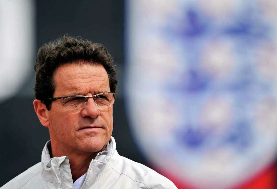 (FILES) In a file picture taken on May 31, 2011 England's Italian manager Fabio Capello attends a training session at London Colney, England. Fabio Capello resigned as manager of England on February 8, 2012 following the Football Association's decision to strip John Terry of the captaincy, the FA confirmed.  AFP PHOTO/GLYN KIRK  NOT FOR MARKETING OR ADVERTISING USE/RESTRICTED TO EDITORIAL USE (Photo credit should read GLYN KIRK/AFP/Getty Images) Photo: GLYN KIRK / AFP