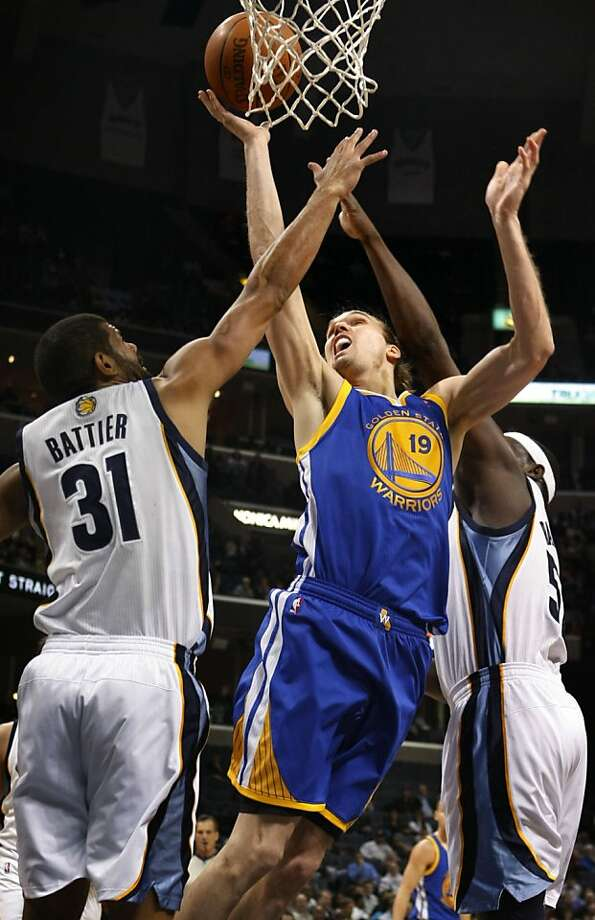 Golden State Warriors forward Lou Amundson (19) shoots under pressure from Memphis Grizzlies forward Shane Battier (31) and another defender in the first half of an NBA basketball game Wednesday, March 30, 2011, in Memphis, Tenn. Photo: Jim Weber, AP