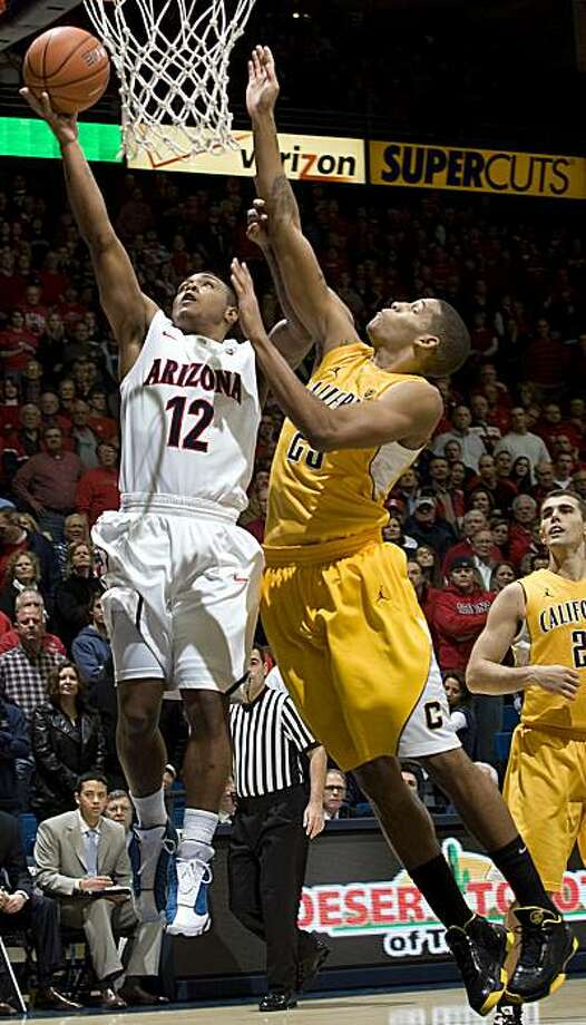 Arizona's Lamont Jones (12) shoots over California's Allen Crabbe (23) during the first half of an NCAA college basketball game at McKale Center in Tucson, Ariz., Thursday, Jan. 6, 2011. Photo: John Miller, AP