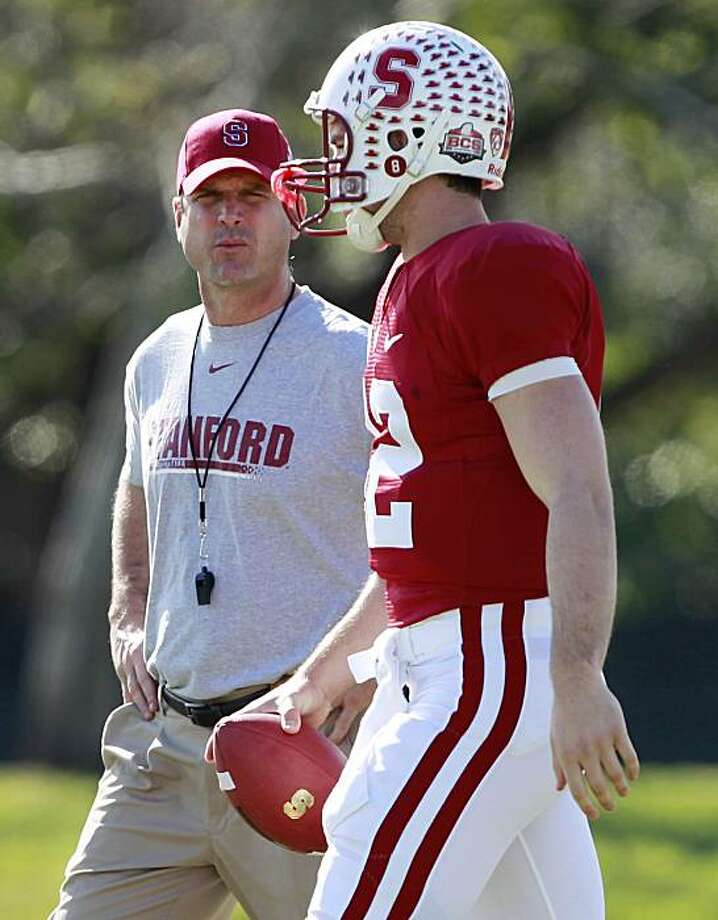 Stanford head coach Jim Harbaugh talks with quarterback Andrew Luck during practice at Barry University in Miami Shores, Fla., Wednesday, Dec. 29, 2010. Stanford is scheduled to play Virginia Tech in the Orange Bowl NCAA college football game on Jan. 3, 2010. Photo: Hans Deryk, AP
