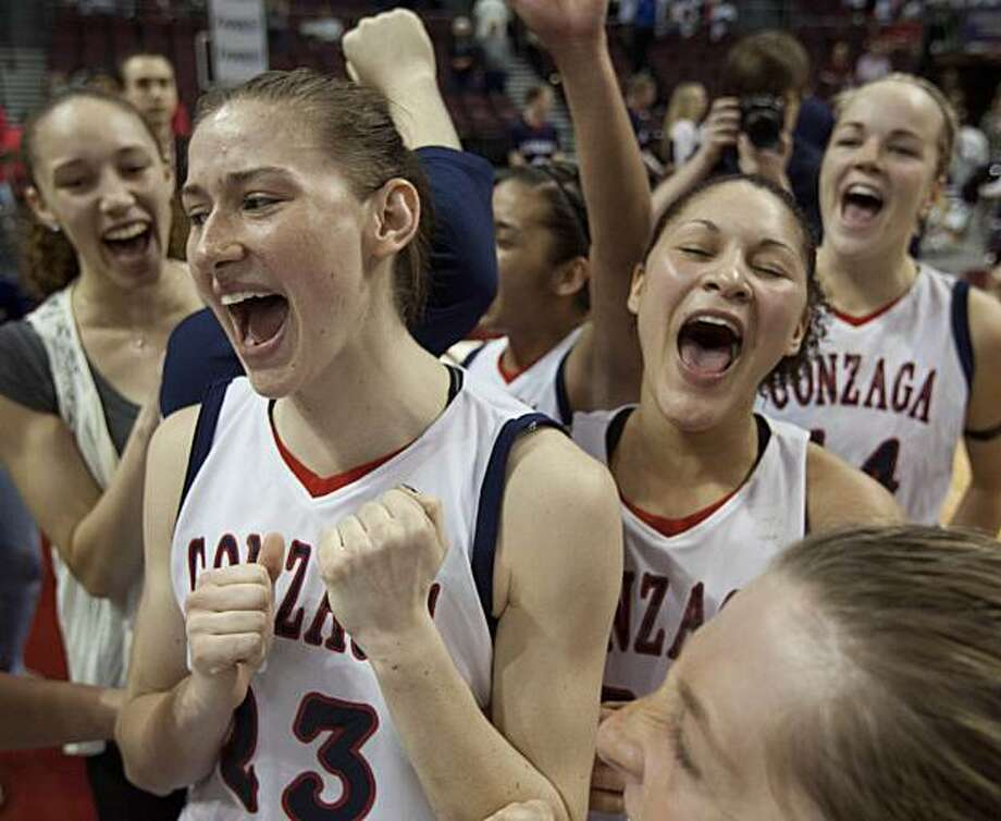 Gonzaga's Katelan Redmon, left, celebrates with teammates after Gonzaga defeated Saint Mary's 72-46 in the championship game of the West Coast Conference women's NCAA college basketball tournament game, Monday, March 7, 2011, in Las Vegas. Photo: Julie Jacobson, AP
