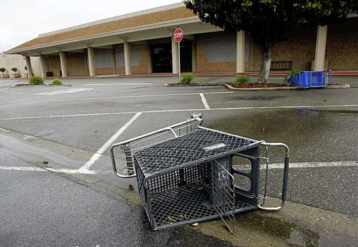Shopping carts lie on their side in the abandoned parking lot in front of a shuttered Mervyn's department store in Dublin, Calif., on Saturday, May 2, 2009.