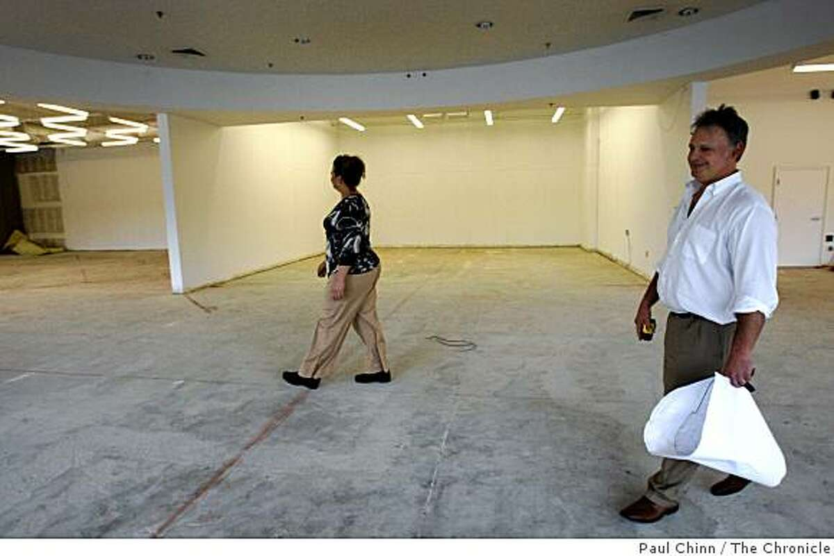 Rachelle Forest and her brother Bret Lowder walk through the former site of a golf store in Dublin, Calif., on Saturday, May 2, 2009. Forest and Lowder operate the The Floor Store chain of flooring stores and are relocating across the parking lot to the Golfsmith site which has been vacant since last Summer.