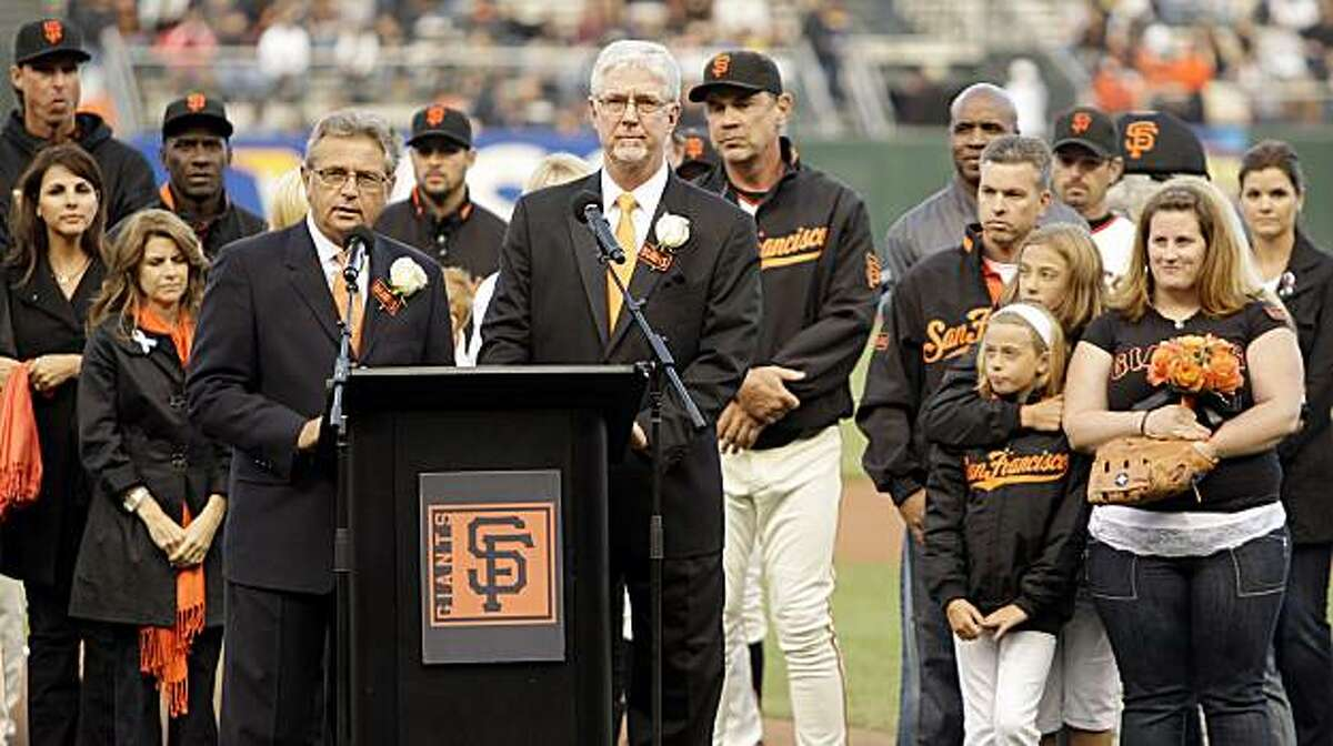 San Francisco Giants announcers Mike Krukow, right of podium, and Duane Kuiper lead a pre-game tribute to Sue Burns, a part owner of the Giants who lost her battle with cancer, prior to a baseball game against the Pittsburgh Pirates Monday, July 27, 2009, in San Francisco. (AP Photo/Ben Margot)