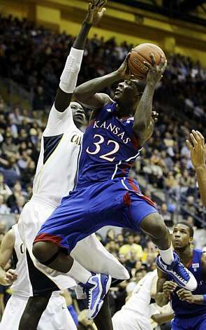 Kansas guard Josh Selby, right, shoots past California forward Bak Bak during the first half of an NCAA college basketball game in Berkeley, Calif., Wednesday, Dec. 22, 2010. Photo: Marcio Jose Sanchez, AP