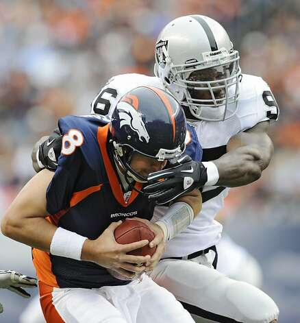 Denver Broncos quarterback Kyle Orton (8) is sacked by Oakland Raiders linebacker Kamerion Wimbley (96) during the first half of an NFL football game, Sunday, Oct. 24, 2010, in Denver. Photo: Jack Dempsey, AP