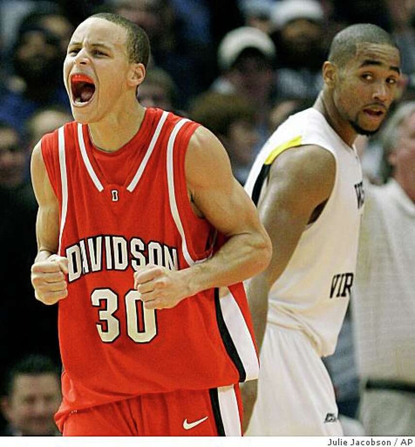 Davidson's Stephen Curry, left, reacts after a West Virginia turnover in the second half during a Jimmy V Classic NCAA college basketball game on  Tuesday, Dec. 9, 2008, at Madison Square Garden in New York. Davidson won 68-65. West Virginia's Da'Sean Butler, right, looked on.(AP Photo/Julie Jacobson) Photo: Julie Jacobson, AP