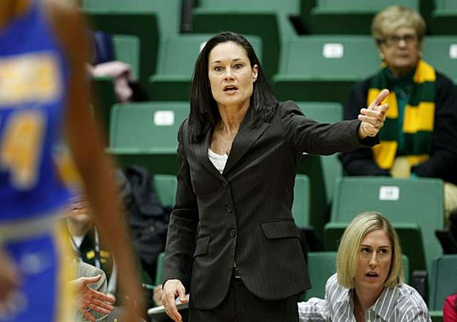 USF head coach Jennifer Azzi tries to get the attention of her players during the first half. Former Olympian and Stanford star Jennifer Azzi is the new women's basketball coach at the University of San Francisco. She coached her team against UC Santa Barbara Sunday December 5, 2010. Photo: Brant Ward, The Chronicle