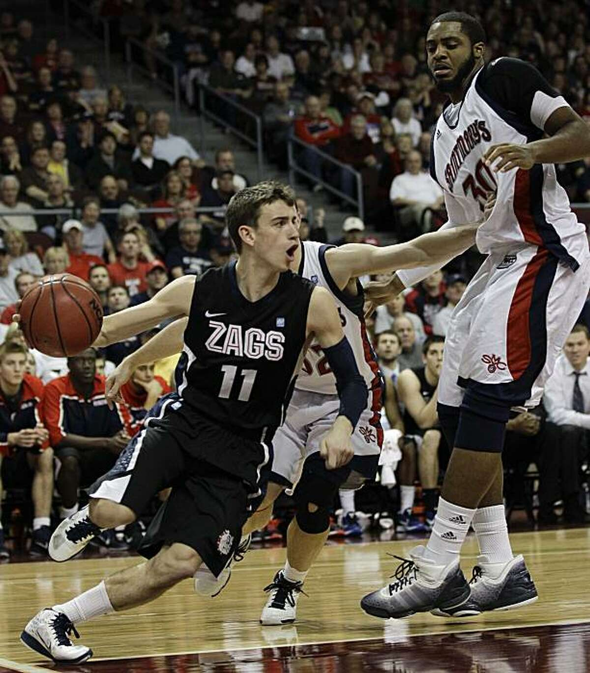 Gonzaga's David Stockton (11) drives past Saint Mary's Kenton Walker II in teh second half during the championship game of the West Coast Conference college basketball tournament, Monday, March 7, 2011, in Las Vegas. Gonzaga won 75-63.