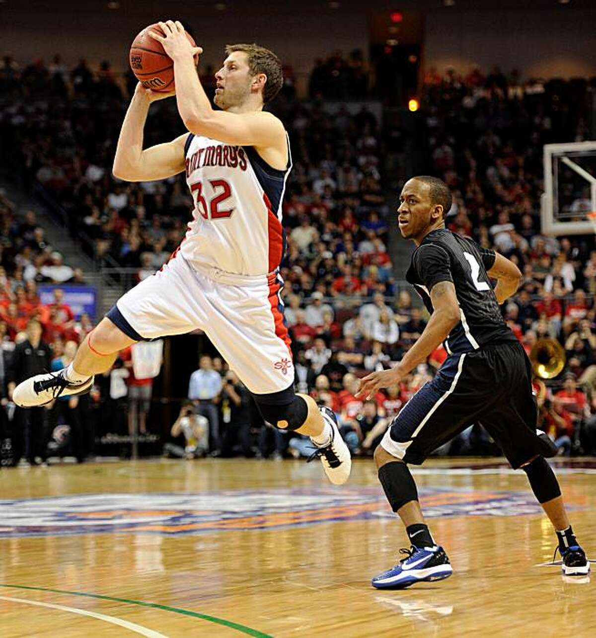 Mickey McConnell of the Saint Mary's Gaels shoots in front of Marquise Carter of the Gonzaga Bulldogs during the championship game of the West Coast Conference tournament at the Orleans Arena on Monday in Las Vegas.