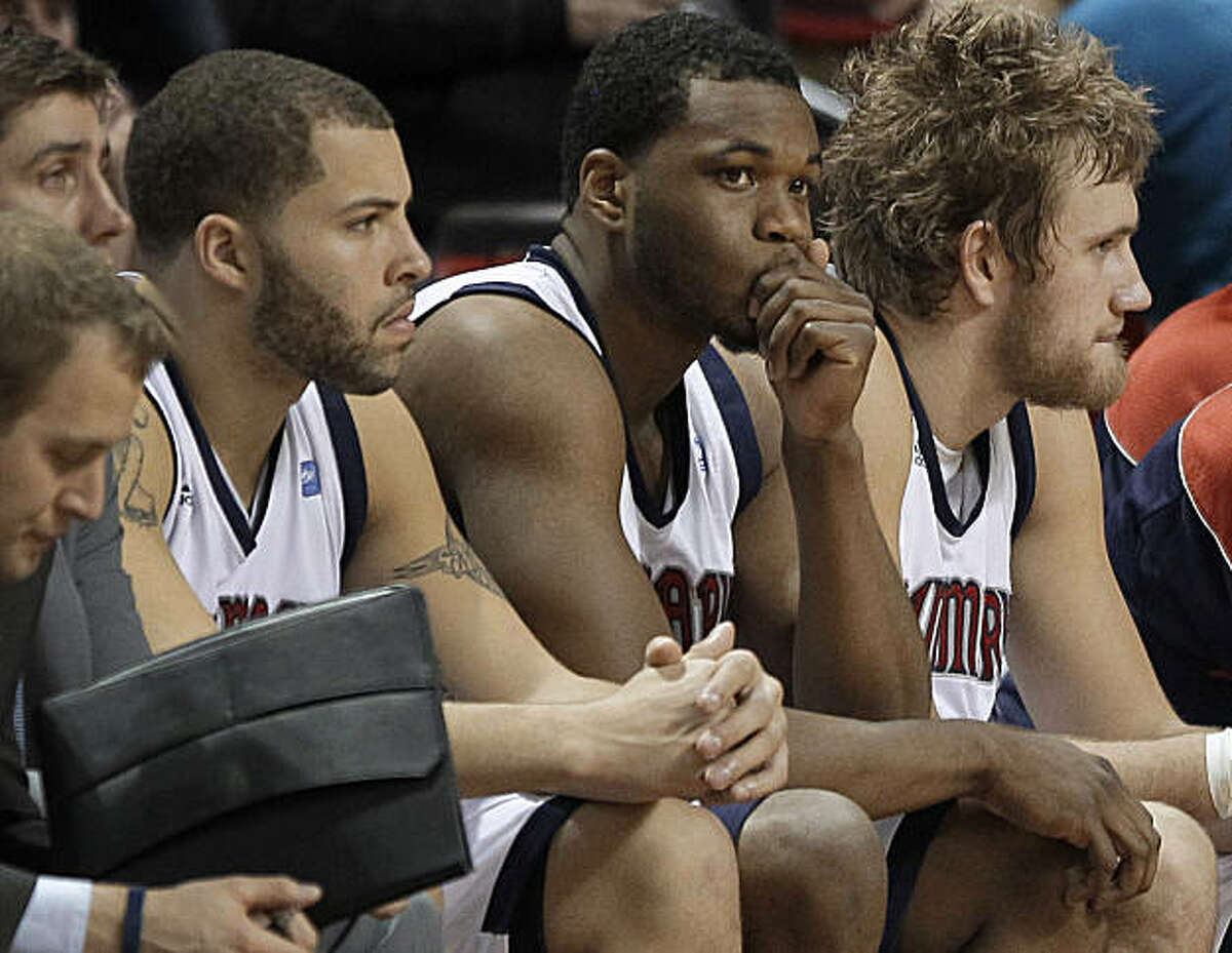 Saint Mary's players watch from the bench in the closing seconds against Gonzaga in an NCAA college basketball game for the championship of the West Coast Conference tournament Monday, March 7, 2011, in Las Vegas. Gonzaga won 75-63.