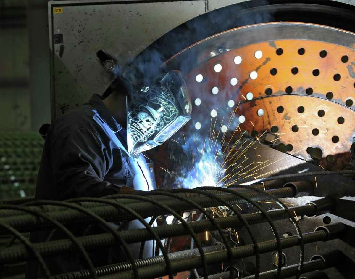 A worker at Dimension Fabricators in Scotia, N.Y. welds joints on a piece of specialty steel fabrication at the shop. ( Skip Dickstein/Times Union)