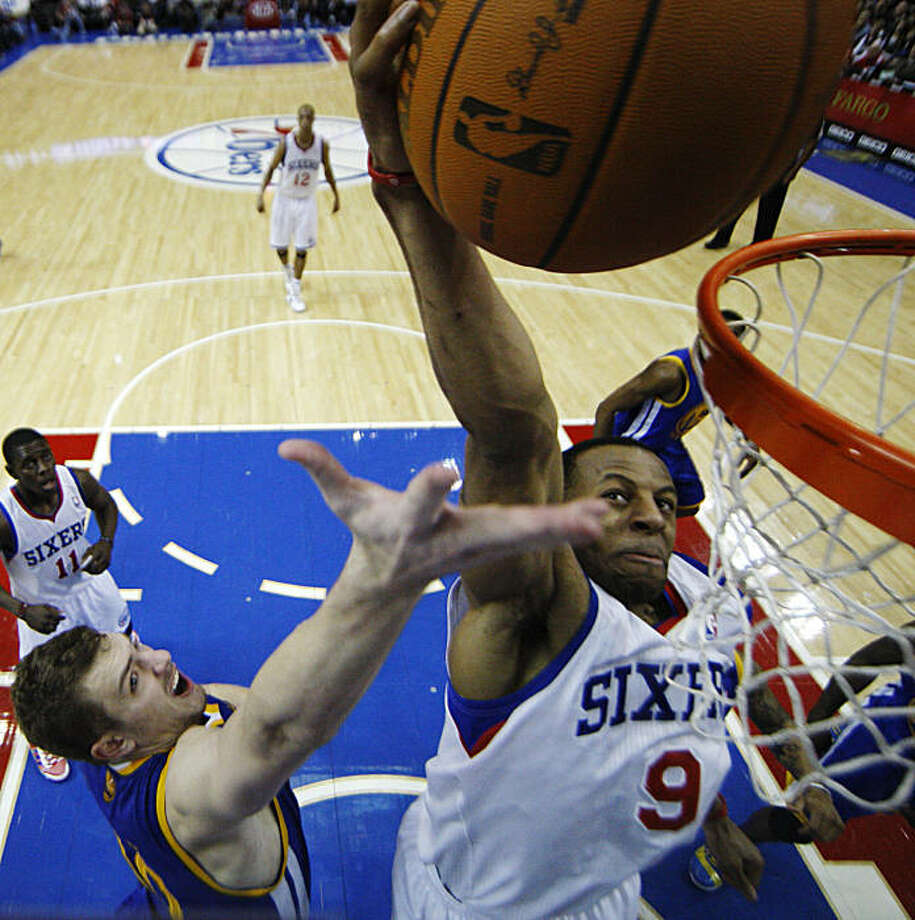 Philadelphia 76ers' Andre Iguodala, right, goes up for a dunk against Golden State Warriors' David Lee in the second half of an NBA basketball game Sunday, March 6, 2011, in Philadelphia. Philadelphia won 125-117 in overtime. Photo: Matt Slocum, AP