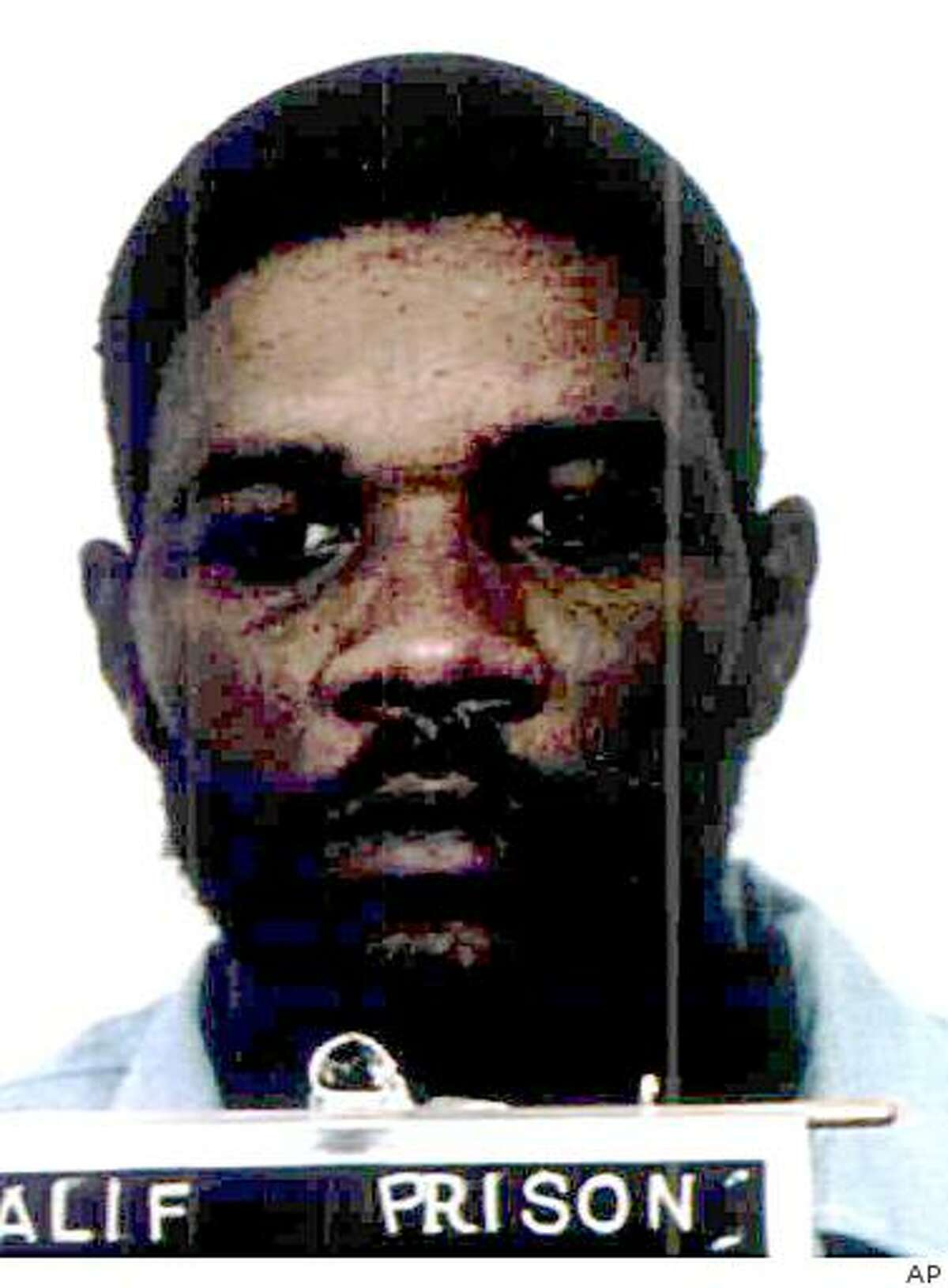 ** FILE ** Kevin Cooper is shown in an undated photo released by California Department of Corrections. Cooper, scheduled to die by lethal injection next month for the savage slayings of four after he escaped a Chino Hills prison in 1983, petitioned Gov. Arnold Schwarzenegger on Friday, Jan. 9, 2004, for new DNA testing that he says will demonstrate his innocence. (AP Photo/California Department of Corrections)