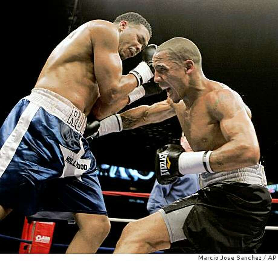 Andre Ward, right, lands a body punch on Rubin Williams during their super middleweight boxing bout in San Jose, Calif., Thursday, March 20, 2008. Ward won the bout by technical knockout.  (AP Photo/Marcio Jose Sanchez) Photo: Marcio Jose Sanchez, AP