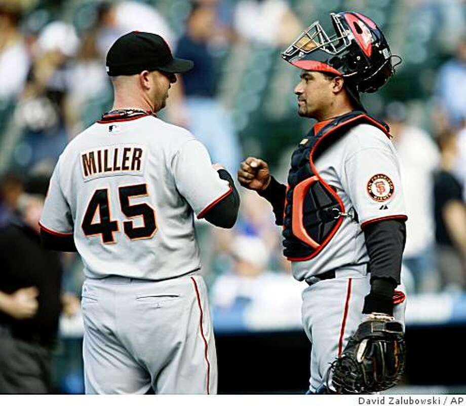 San Francisco Giants relief pitcher Justin Miller, left, congratulates catcher Bengie Molina after the Giants' 8-3 victory over the Colorado Rockies in a game in Denver on Thursday, May 7, 2009. Molina keyed the Giants' win with two home runs and four RBIs. Photo: David Zalubowski, AP