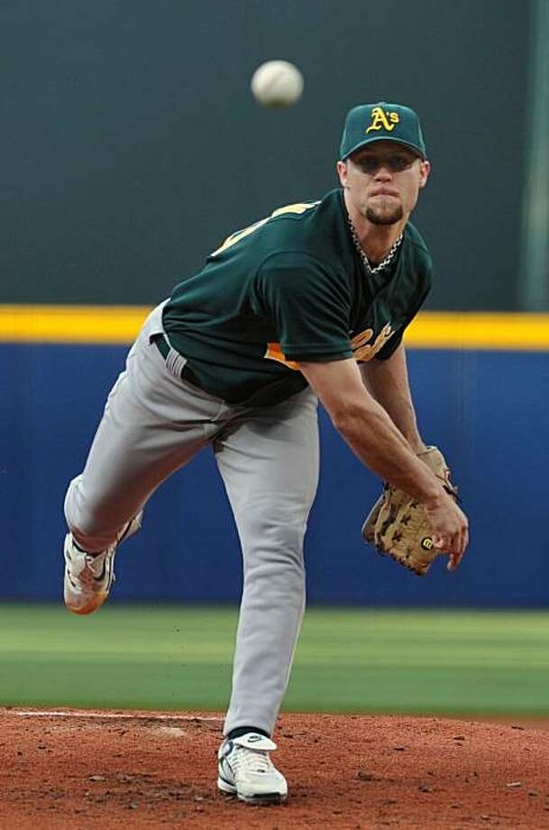 Oakland Athletics starter Rich Harden delivers to the Atlanta Braves during the first inning of a Major League Baseball game, Saturday, May 17, 2008, at Turner Field in Atlanta. (AP Photo/Gregory Smith) Photo: Gregory Smith, AP