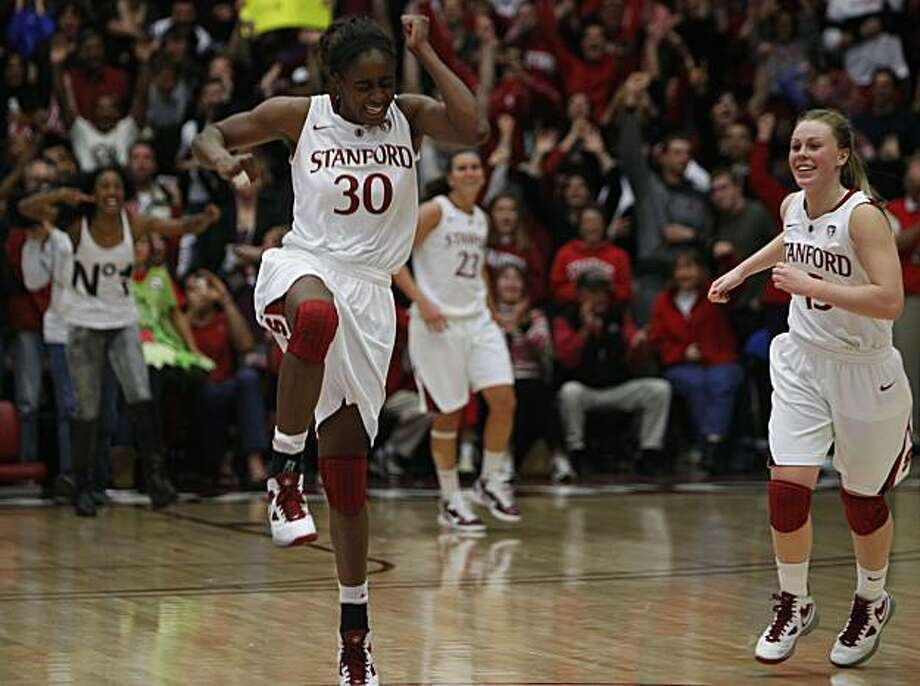 Nneka Ogwumike and Lindy La Rocque whoop it up after the Stanford Cardinal's 71-59 win over the UConn Huskies at Maples Pavilion in Stanford, Calif., on Thursday, Dec. 30, 2010. Photo: Paul Chinn, The Chronicle