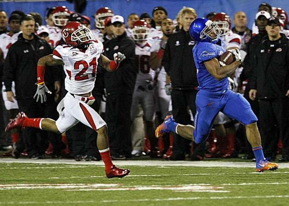 9889da6d6 Boise State running back Doug Martin, right, runs 84 yards for touchdown as  Utah's