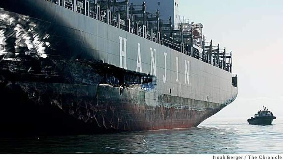 busan_nb7 An approximately 90-foot long gash stretches down the Cosco Busan's hull as it rests at anchor on Tuesday, Nov. 13, 2007, in the San Francisco Bay, Calif. The vessel struck the Bay Bridge last Wednesday spilling about 58,000 gallons of oil into the bay.BY NOAH BERGER/SPECIAL TO THE CHRONICLE.EDITOR: DO NOT RELEASE TO ANY WIRE OR OTHER NEWSPAPER. CHRONICLE USE ONLY. Ran on: 11-14-2007The Cosco Busan, at anchor in San Francisco Bay, has a gash in its hull where it hit a fender protecting one of the towers of the Bay Bridge last week.Ran on: 11-14-2007The Cosco Busan, at anchor in San Francisco Bay, has a gash in its hull where it hit a fender protecting one of the towers of the Bay Bridge last week. Photo: Noah Berger, The Chronicle