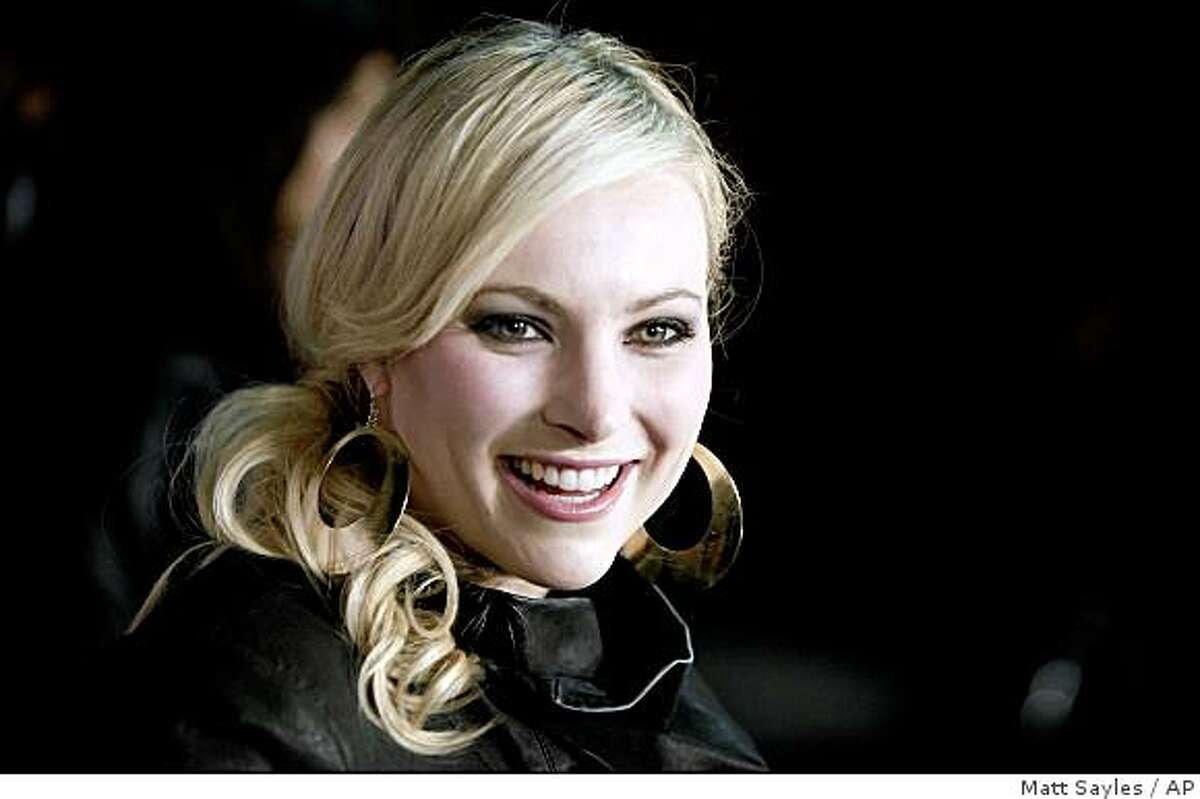 """FILE- this March 28, 2009 file photo shows Meghan McCain, daughter of Sen. John McCain, arriving at Perez Hilton's 31st Birthday Party in West Hollywood, Calif. McCain will write a book about her experience as a progressive Republican. McCain, who campaigned for her father during the 2008 presidential race, will """"delve into what it means to love the Republican party, while not always fitting in,"""" says publisher Hyperion, which inked a deal with McCain. (AP Photo/Matt Sayles,File)"""
