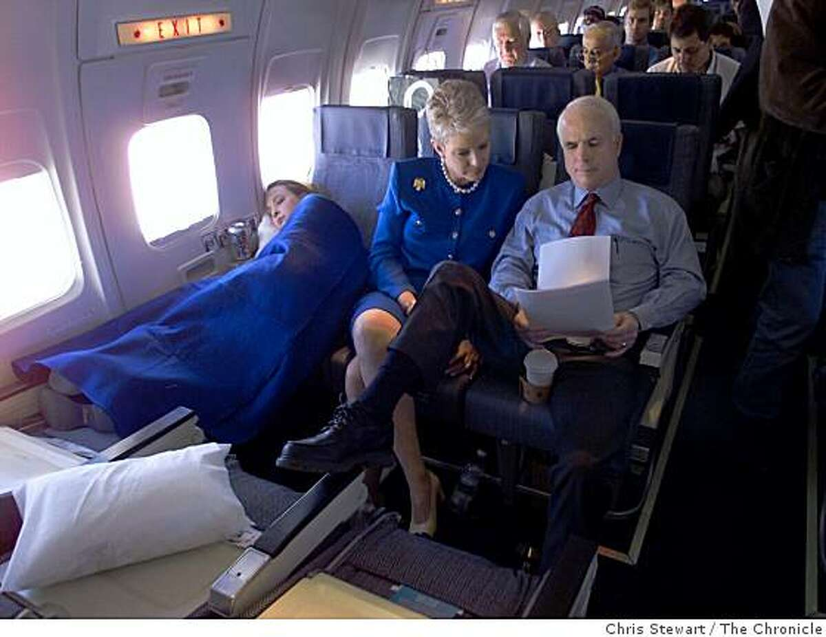 Republican presidential candidate Senator John McCain, his wife Cindy and their 15-year-old daughter Meghan aboard their charter flight flying from San Jose to Southern California as part of his pre-primary swing through California on March 6, 2000.