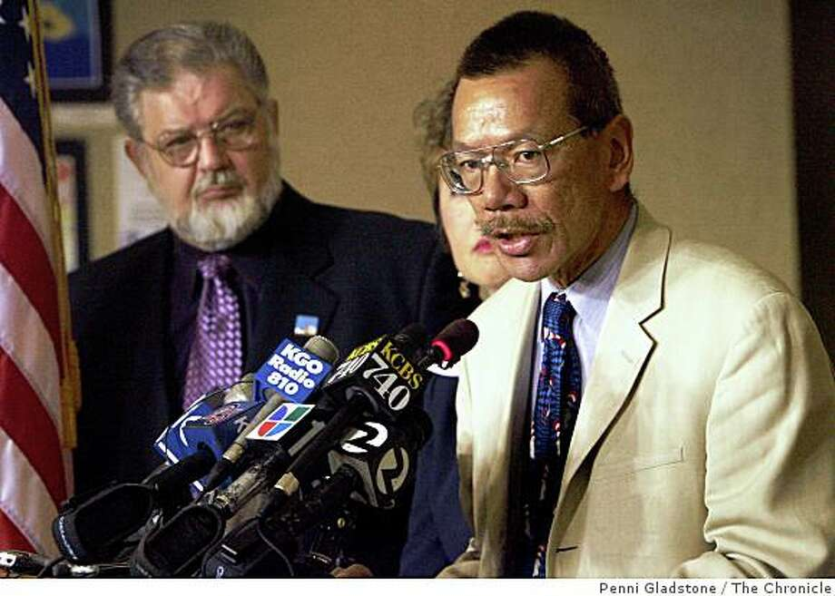 at left is Dennis Kelly, Pres. of United Educators of San Francisco, Gwen Chan is Interium Superintendent, speaking is Norman Yee, Pres. of the Board of Ed. Photo: Penni Gladstone, The Chronicle