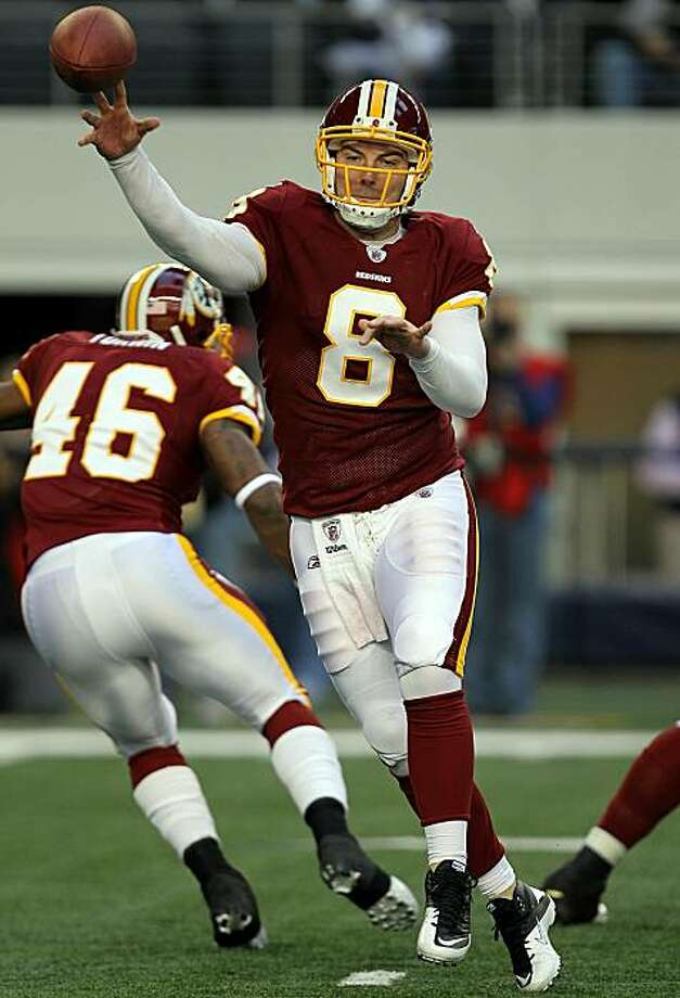 ARLINGTON, TX - DECEMBER 19:  Quarterback Rex Grossman #8 of the Washington Redskins passes against the Dallas Cowboys in the first quarter at Cowboys Stadium on December 19, 2010 in Arlington, Texas. Photo: Ronald Martinez, Getty Images