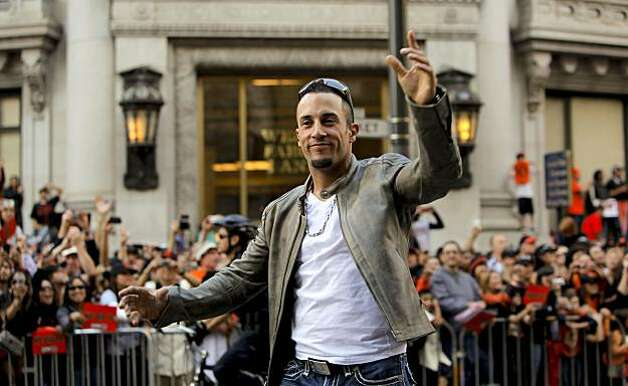 Giants' Andres Torres waves to fans, as the City of San Francisco celebrates the World Series Champion Giants with a parade down Market Street, on Wednesday Nov. 3, 2010 in San Francisco, Calif. Photo: Michael Macor, San Francisco Chronicle